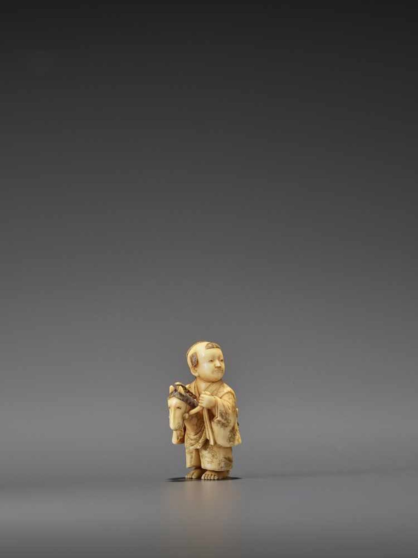 RYOMIN: A VERY FINE IVORY NETSUKE OF A BOY WITH HOBBY HORSE By Ono Ryomin, signed Ryomin with - Image 8 of 11