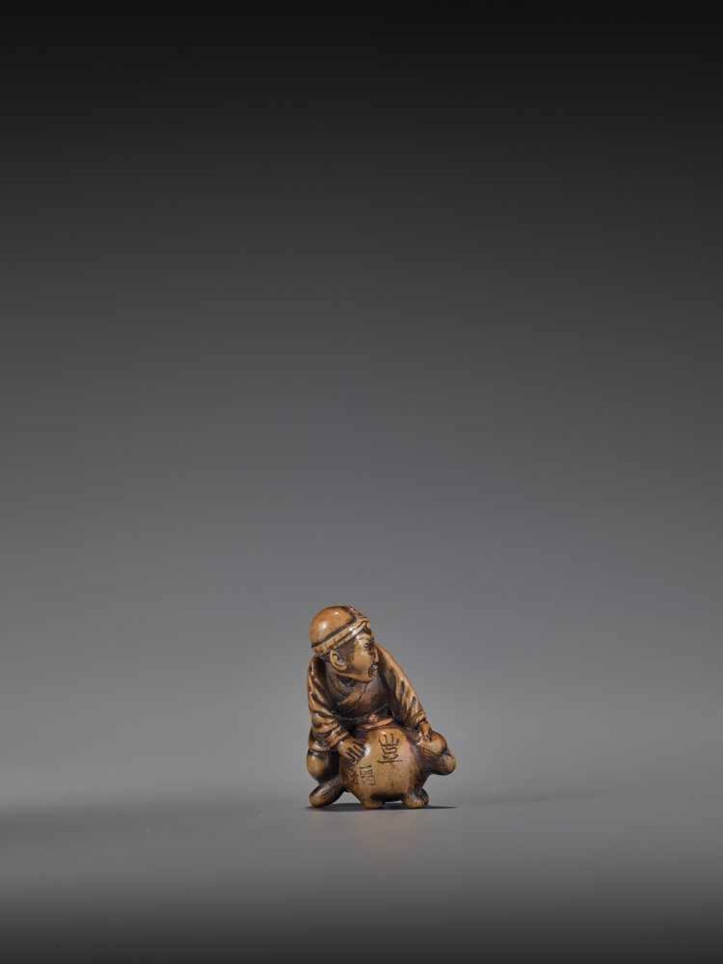 HIDEHISA: A RARE WOOD NETSUKE OF A THIEF STEALING THE MAGIC TANUKI KETTLE By Hidehisa, signed - Image 9 of 12