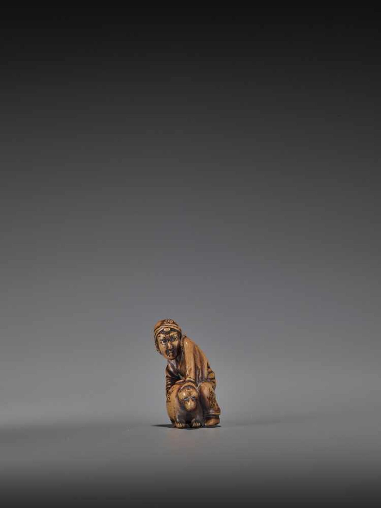 HIDEHISA: A RARE WOOD NETSUKE OF A THIEF STEALING THE MAGIC TANUKI KETTLE By Hidehisa, signed - Image 4 of 12