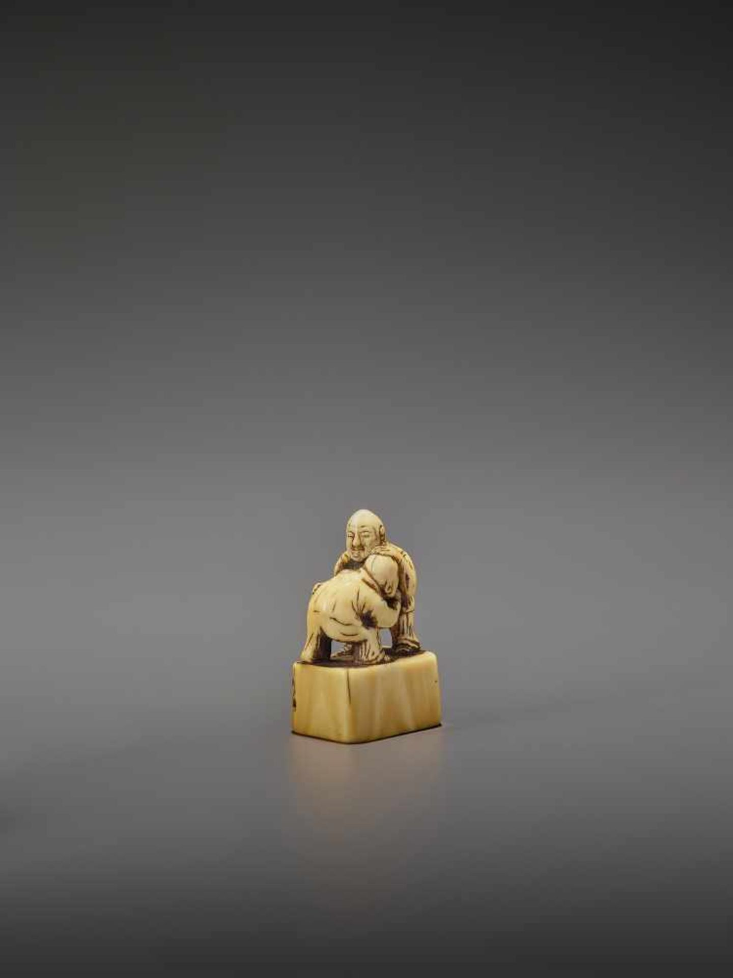 AN EARLY IVORY NETSUKE OF TWO CHINESE WRESTLERS UnsignedJapan, early 18th century, Edo period (