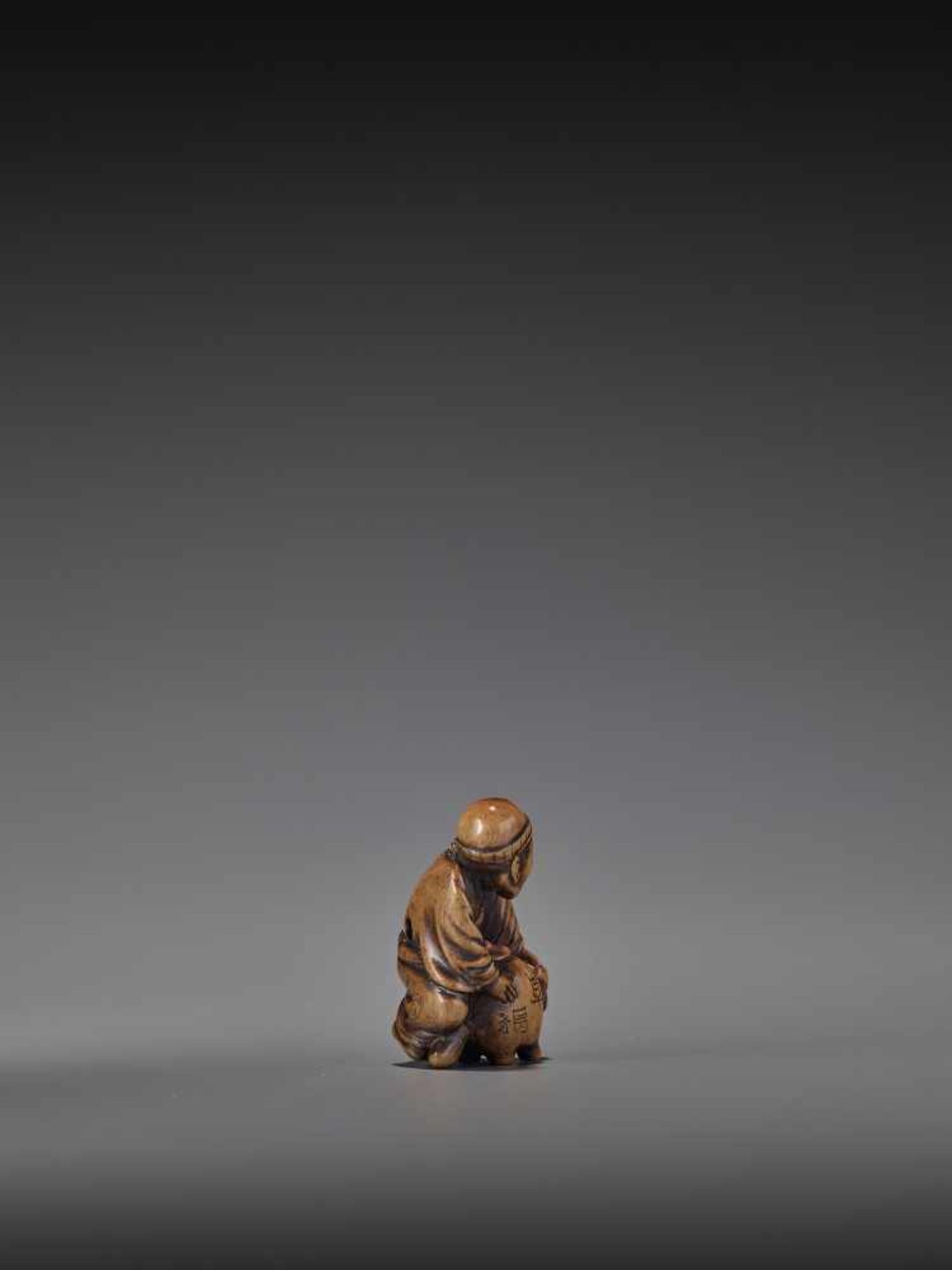 HIDEHISA: A RARE WOOD NETSUKE OF A THIEF STEALING THE MAGIC TANUKI KETTLE By Hidehisa, signed - Image 8 of 12