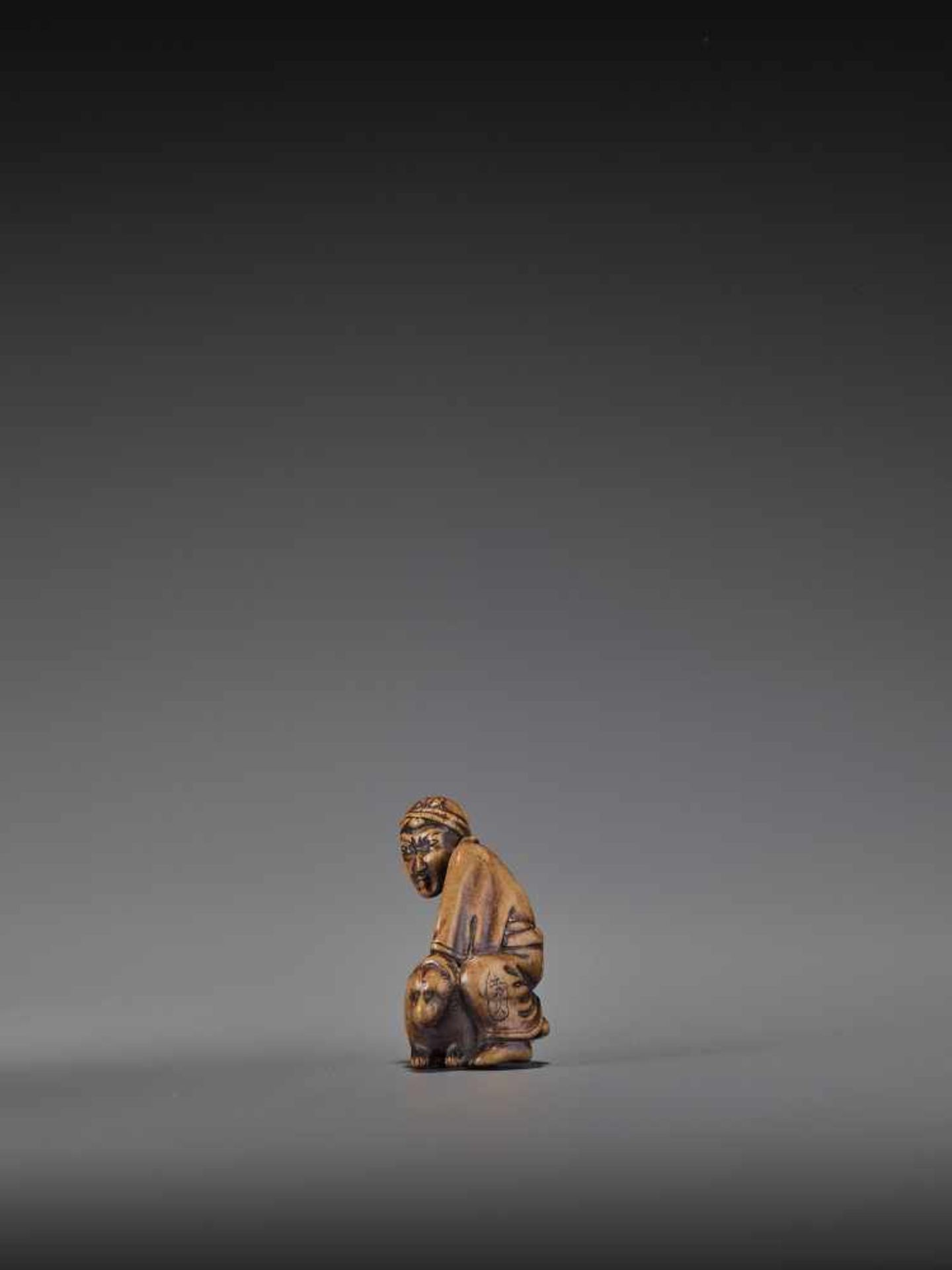 HIDEHISA: A RARE WOOD NETSUKE OF A THIEF STEALING THE MAGIC TANUKI KETTLE By Hidehisa, signed - Image 5 of 12