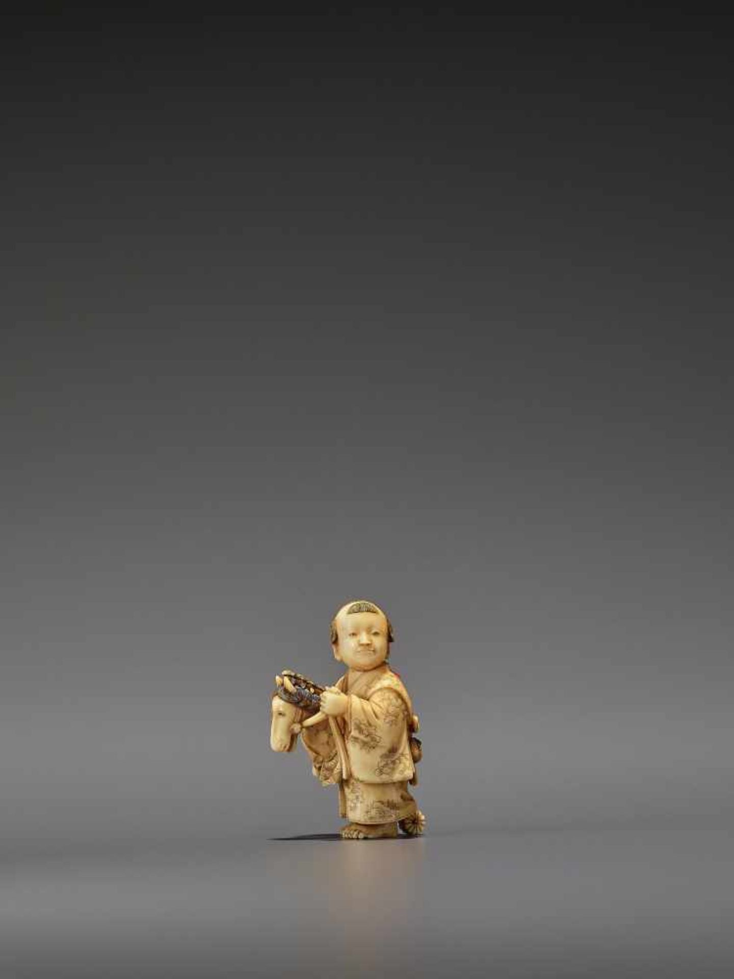 RYOMIN: A VERY FINE IVORY NETSUKE OF A BOY WITH HOBBY HORSE By Ono Ryomin, signed Ryomin with - Image 3 of 11