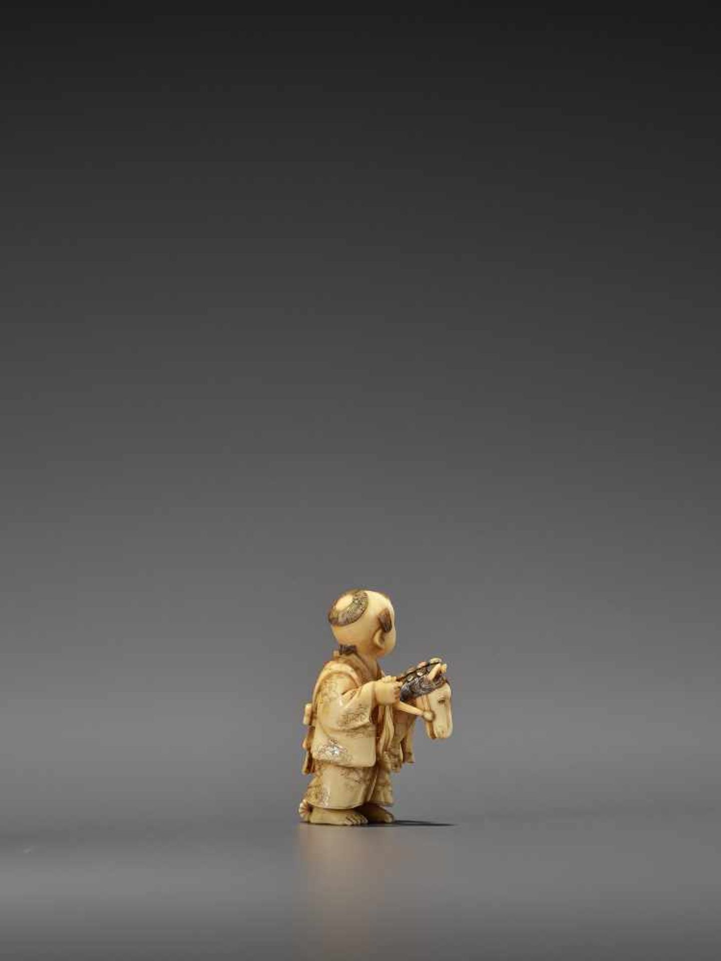 RYOMIN: A VERY FINE IVORY NETSUKE OF A BOY WITH HOBBY HORSE By Ono Ryomin, signed Ryomin with - Image 5 of 11