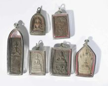 Six antique buddhist amulet pendants, each set in a modern pendant under glass, from 3.5