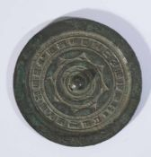 Small mirror with ornaments and calligraphy, China, iron (193g), probably Han-Dynasty,