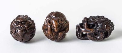 Three netsuke of a sheep and two dragons, Japan, woodcarving, signed, probably around1900, height:
