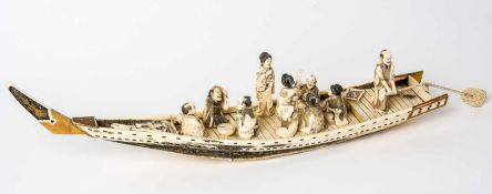 Rowing boat with funny company, Japan, ivory carving, signed, probably around 1900,Length: ca. 68 cm