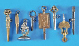 Bundle wit 7 old pocket watch keys and 1 signetKonvolut mit 7 alten Taschenuhrschlüsseln und 1