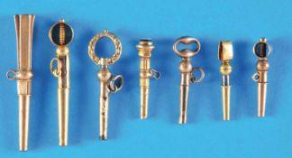 Bundle with 6 old golden pocket watch keysKonvolut mit 6 alten goldenen Taschenuhrschlüsseln, zum