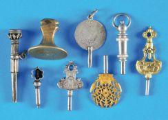 Bundle with 7 old pocket watch keys and 1 signetKonvolut mit 7 alten Taschenuhrschlüsseln und 1
