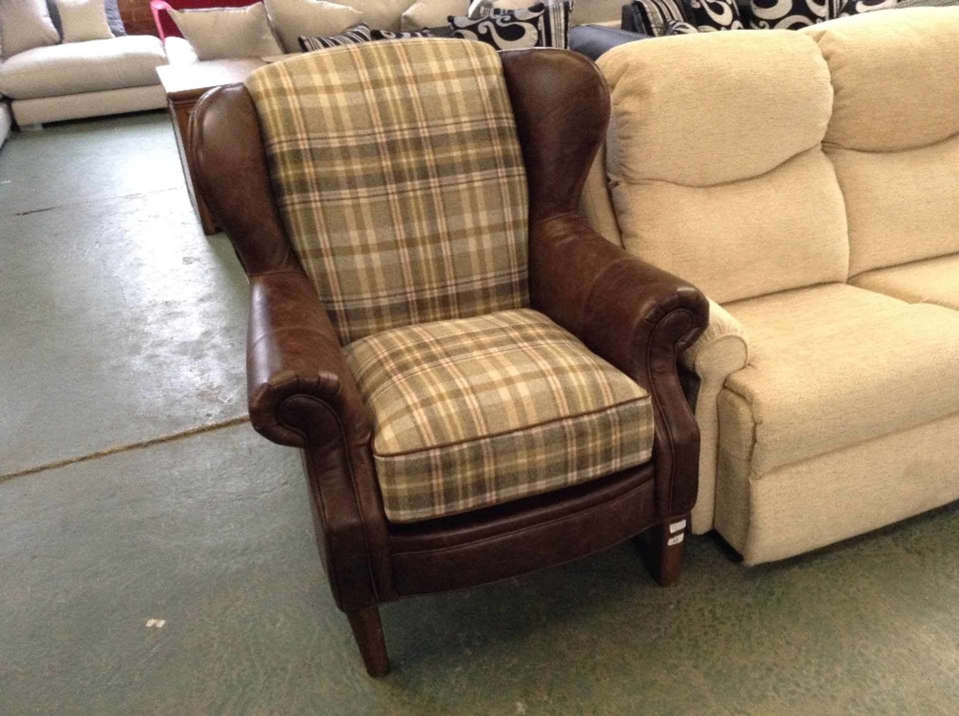 Lot 43 - BROWN HALF HIDE WING CHAIR (WM23-11)