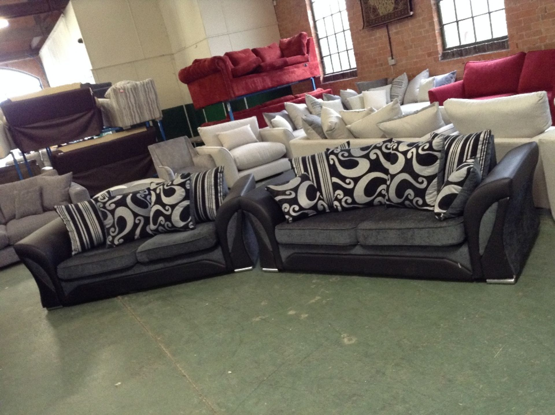 Lot 32 - CHARCOAL AND BLACK 2 X 2 SEATER SOFAS (SCUFFED ON