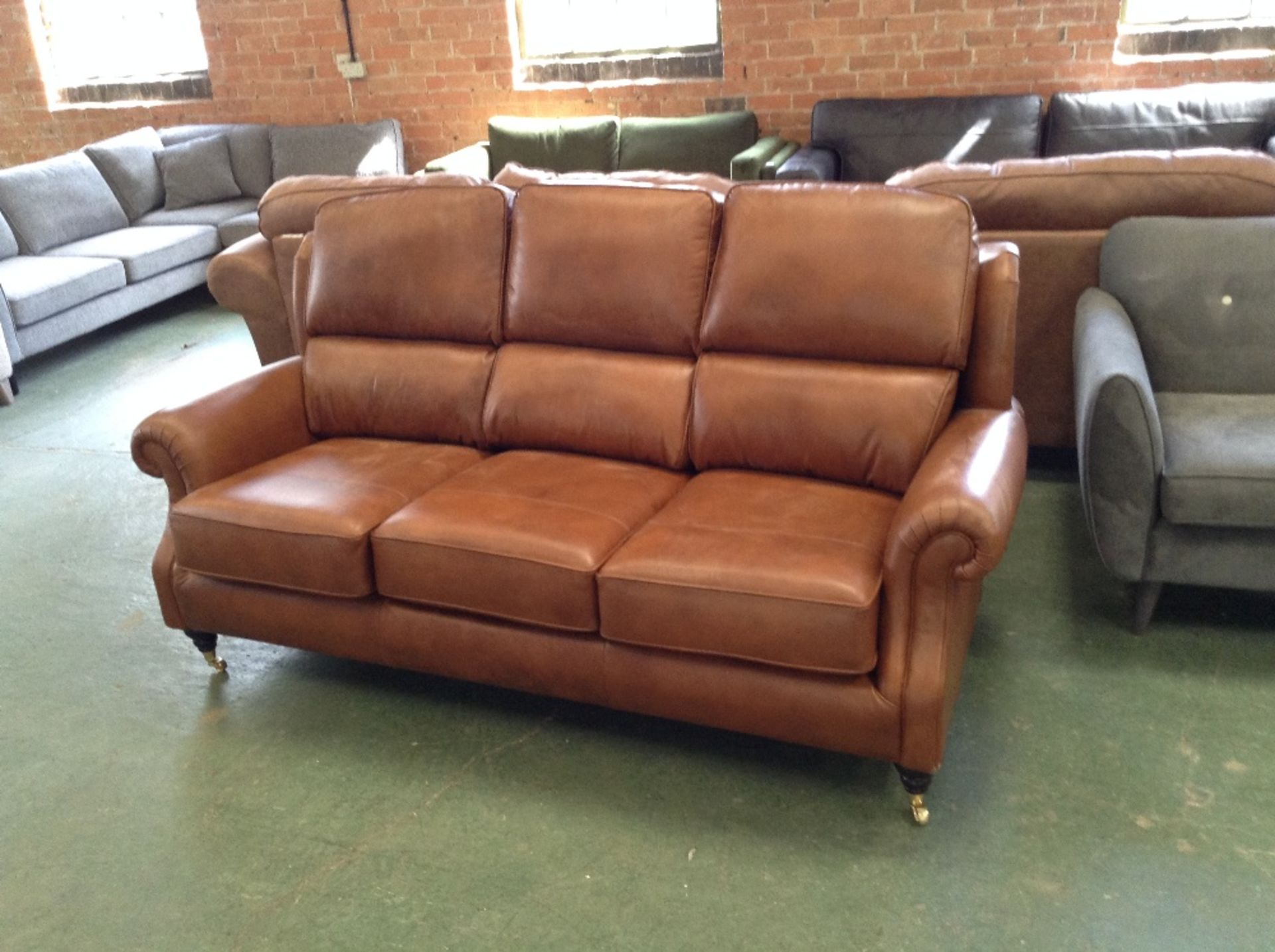 Lot 38 - BROWN LEATHER HIGH BACK 3 SEATER SOFA (SCUFFED ON