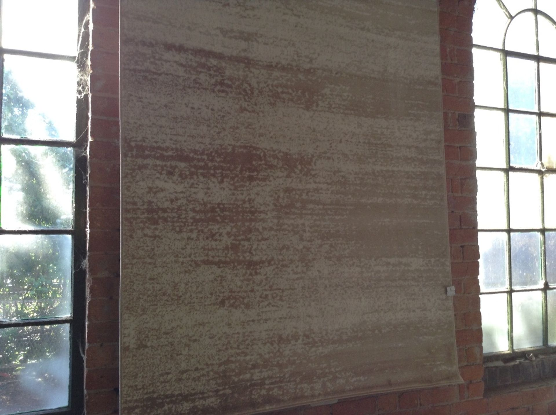 Lot 6 - BROWN AND WHITE RUG