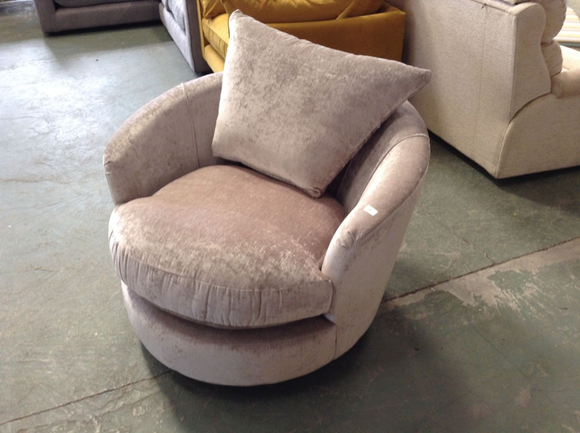 Lot 31 - BEIGE SWIVELING CUDDLE CHAIR