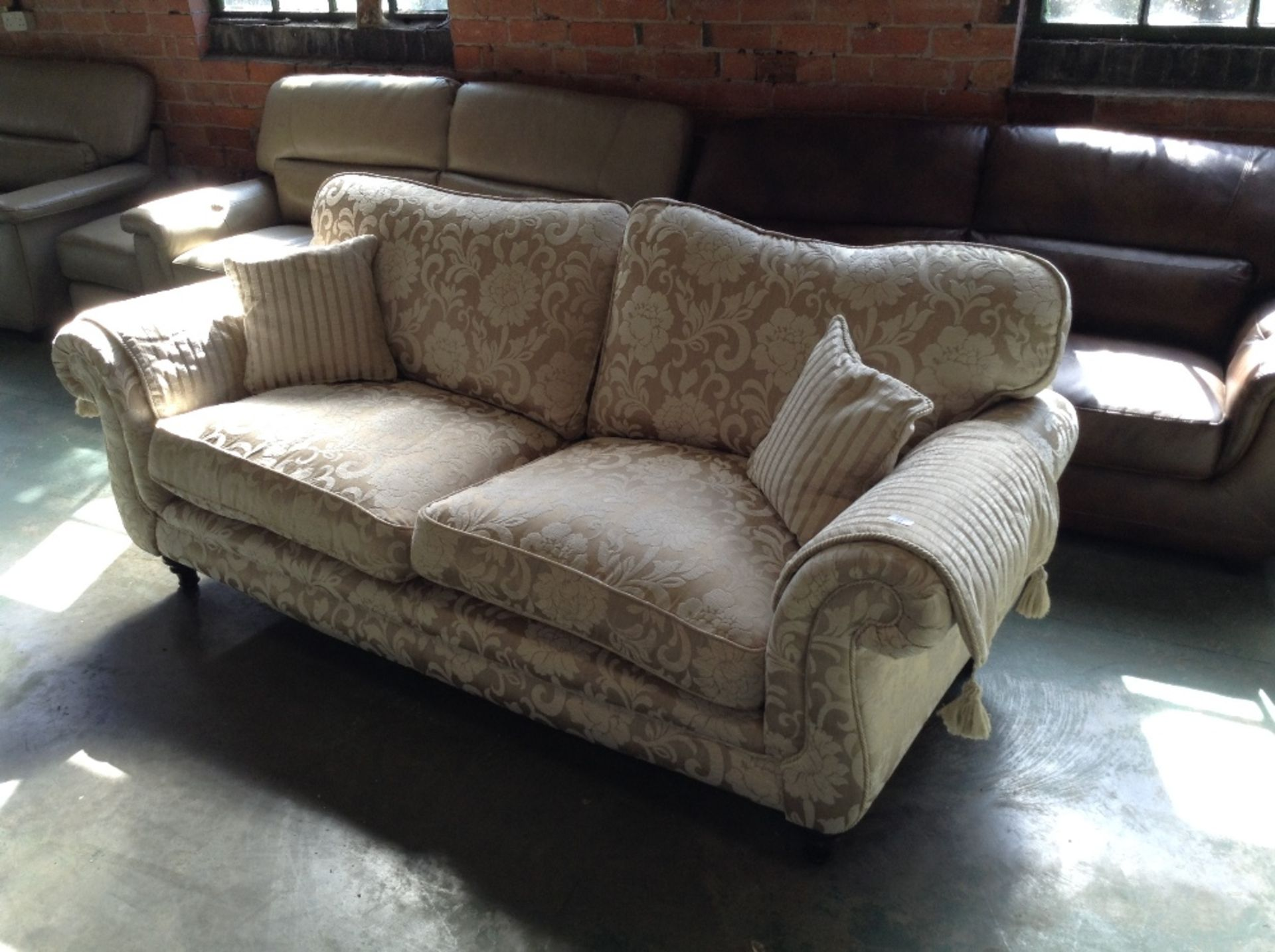 Lot 22 - NATURAL AND GOLD FLORAL PATTERNED 3 SEATER