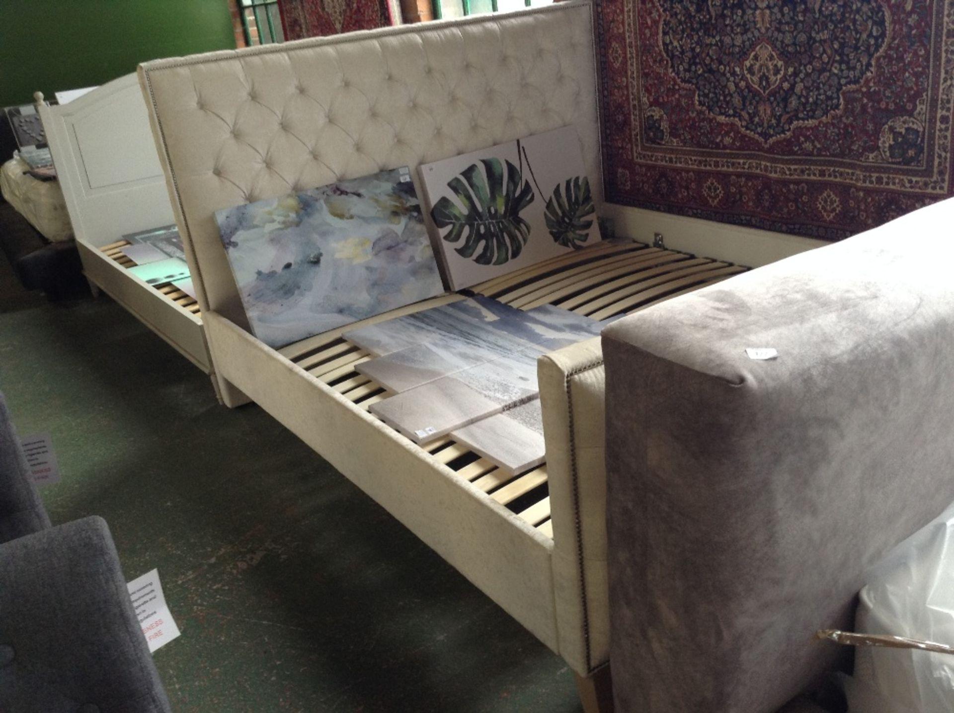 Lot 184 - CREAM UPHOLSTERED 6 FT BED FRAME