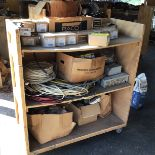 Lot 45 - WOODEN MEDIA CART ON CASTER WHEELS LOADED WITH MISC ELECTRICAL SUPPLIES