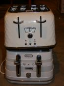 Lot to Contain 2 Assorted Items to Include Delonghi Brilliante and Delonghi Avolta 4 Slice Toaster