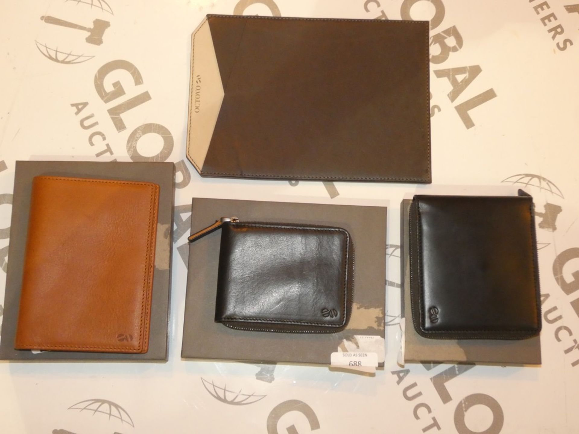 Lot 1003 - Boxed Assorted Octovo Brand New Items to Include Wallets and Coin Holders