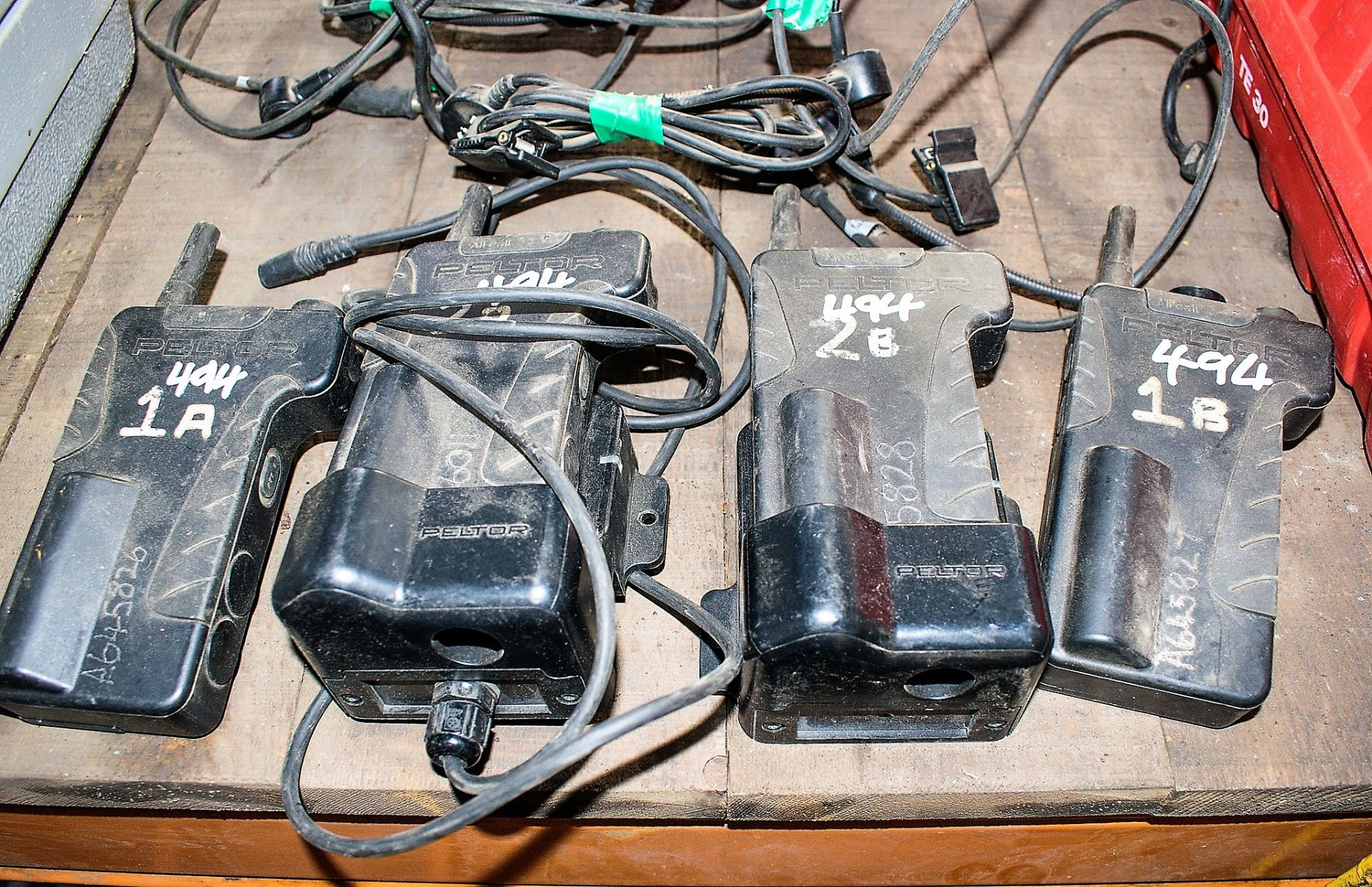 Lot 494 - 4 - Peltor 2 way radios c/w 2 - chargers & 4 - headsets