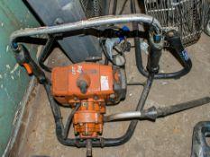 Petrol driven post hole borer