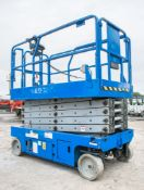 Genie GS3246 battery electric scissor lift Year: 2004 S/N: 61762 Recorded Hours: 566
