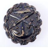 Verwundetenabzeichen der Marine 1918 in SchwarzAbzeichen in der Ausführung Eisen geschwärzt.