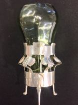 Lot 4 - A silver Art Nouveau flower vase with six stylised tulip heads. Green glass liner, maker William
