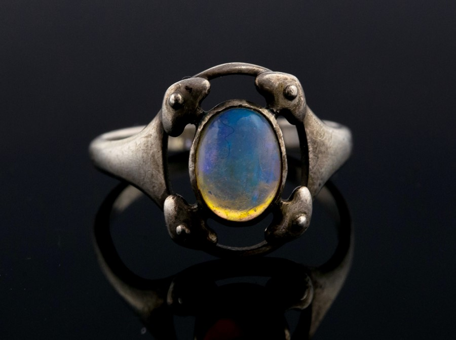 Lot 12 - Murrle Bennett & Co - An Arts and Crafts silver and opal ring, size M, stamped M.B.C, 2.5gms