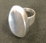 Lot 27 - N.E.From silver modernist ring c.1950 plain oval concave form, dimensions approx 25mm x 14mm. Ring
