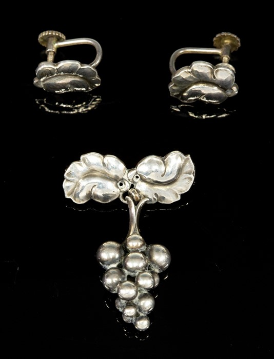 Lot 8 - Georg Jensen (attributed) - a Danish modernist brooch with stylised grapes, suspended from foliate