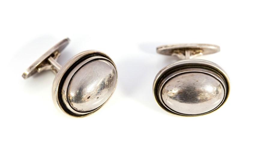 Lot 38 - Georg Jensen -Harald Nielsen for Georg Jensen, a pair Danish modernist silver cufflinks, number