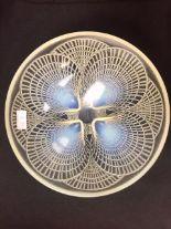 "Lot 57 - A Rene Lalique (1860 - 1945) opalescent ""Coquilles"" glass bowl. Engraved 'R Lalique', pre 1945."