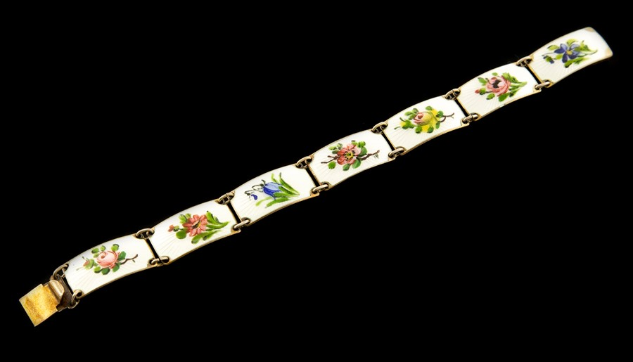 Lot 10 - Finn Jensen - a Norwegian silver and enamel bracelet, seven panels painted with colourful flowers on
