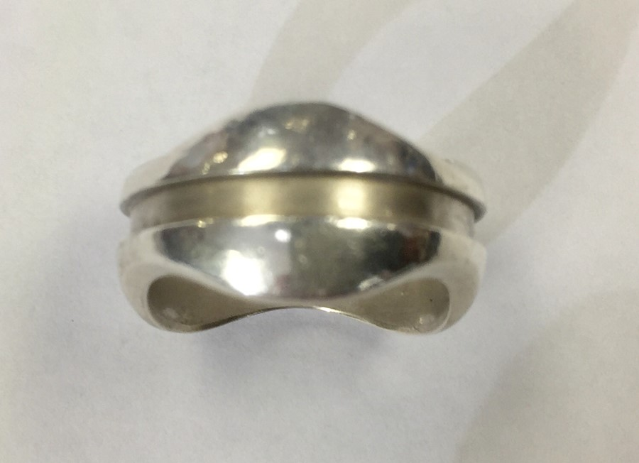 Lot 26 - Georg Jensen - by Regitze Overgaard - sterling silver ring, wave form with line detail, approx. 10mm