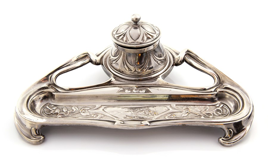 Lot 3 - An electro plated silver art nouveau style inkwell, with floral design, circa 1900. Missing ink