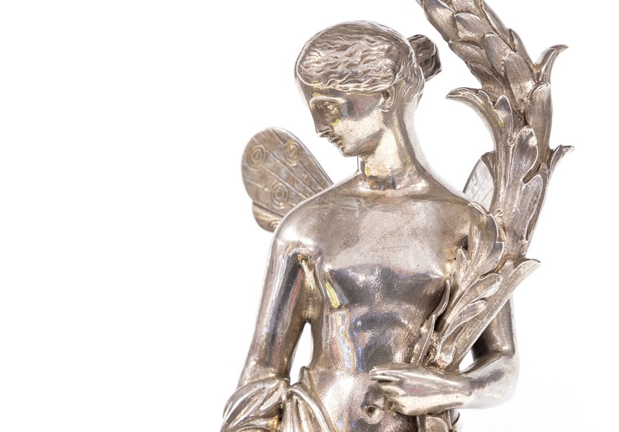 Lot 1 - A mid Victorian silver table centrepiece, pierced basket over a winged angel sheltering under a palm