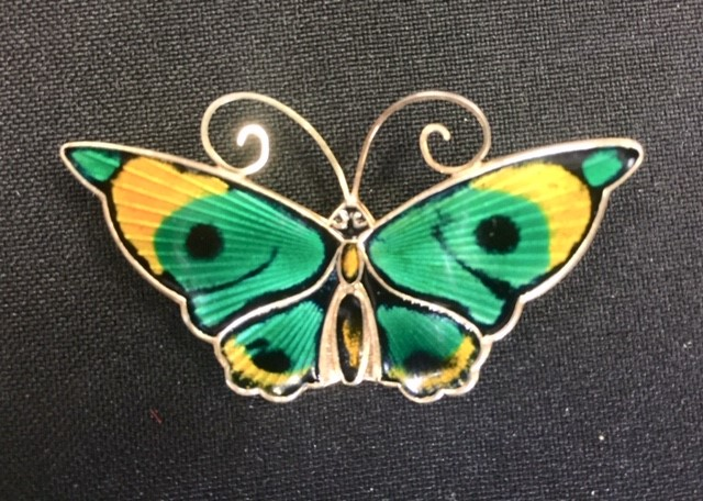 Lot 18 - David Andersen - a large Norwegian silver gilt and enamel butterfly brooch, in tones of green,