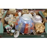 Lot 1457A - A box of mixed ceramics to include teapots, vases, egg cups, cups, saucers,