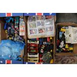 Lot 3292 - Two boxes of assorted diecast vehicles and Beatrix Potter books and cigarette cards