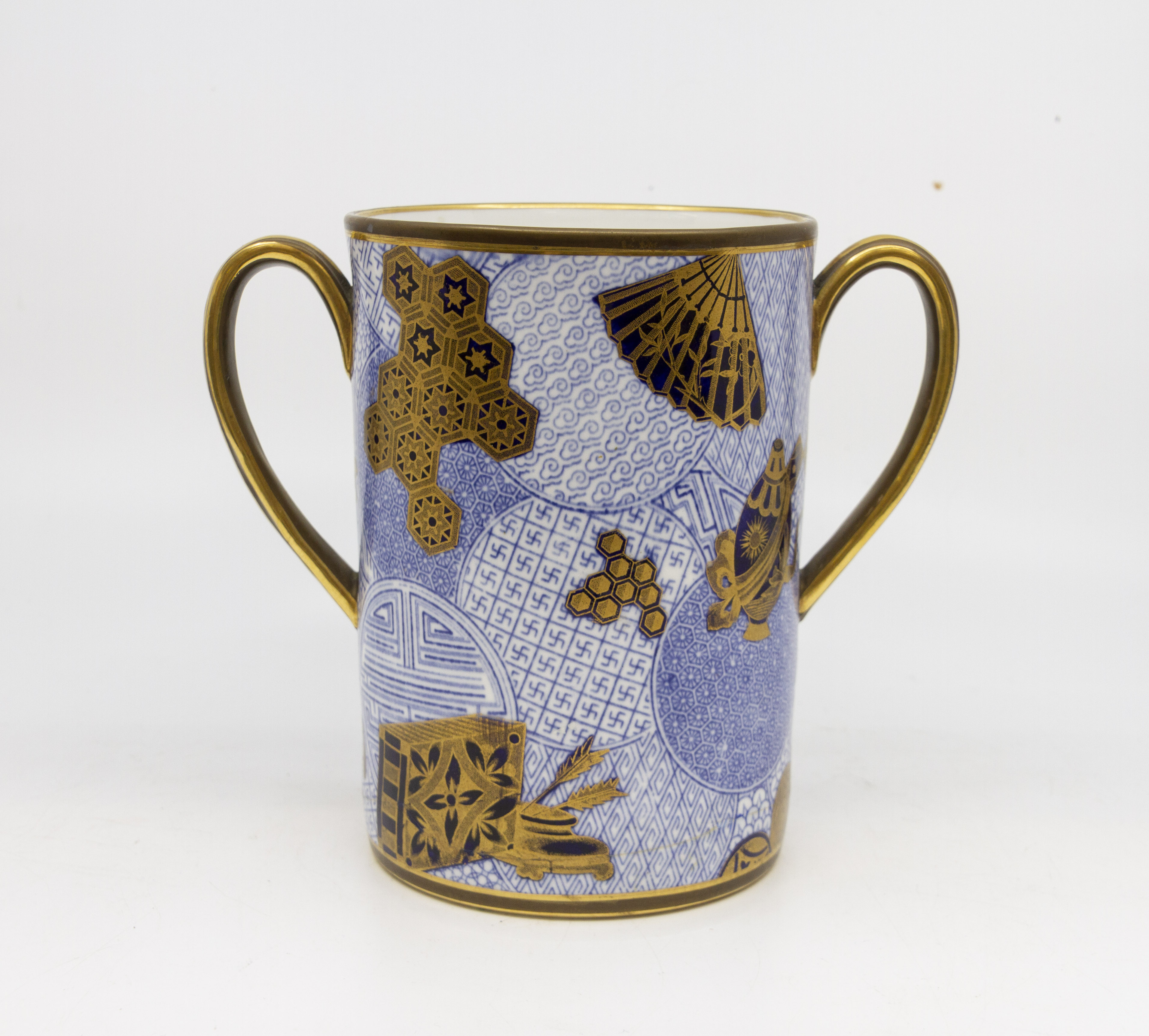 Lot 1287A - A Royal Worcester Cylindrical Twin Handled Cup, 1878 date code, 11cm diam 15.5cm high.