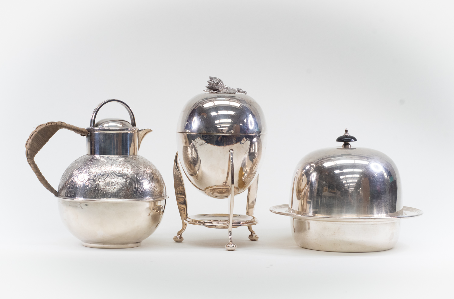 Lot 2 - A silver plated Asprey muffin dish, a silver plated egg coddler, together with a Garrard & Co plated