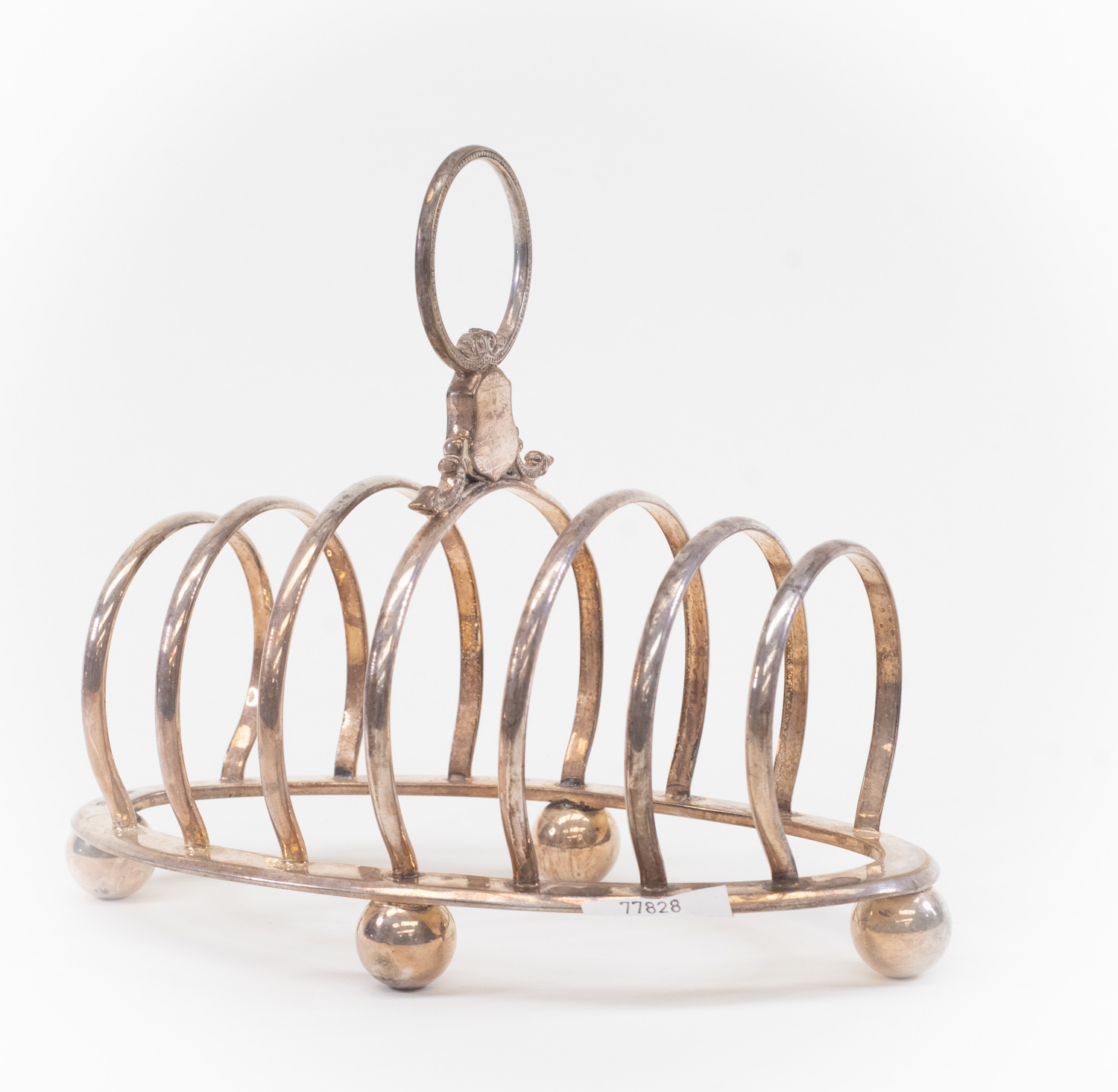 Lot 4 - A silver plated toast rack, bearing military bearings