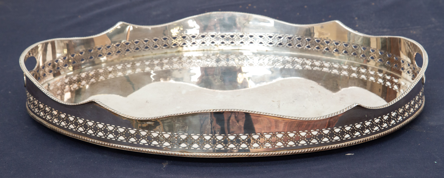 Lot 1A - An electroplated oval gallery drinks tray