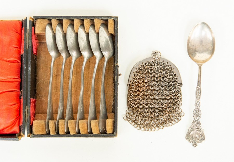Lot 16 - Metal ware including; six tea spoons, Chatelaine purse and ornate spoon (3)