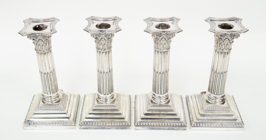 Lot 6 - Two pairs of plate candlesticks, classical column form