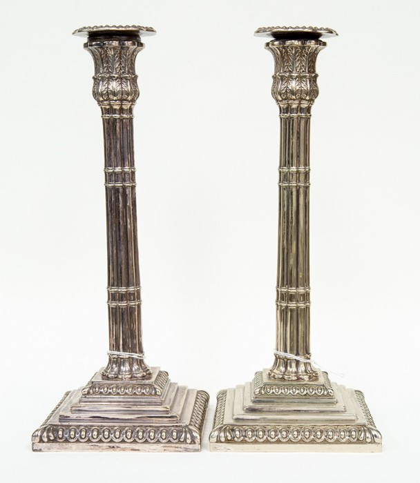 Lot 5 - A pair of silver plated column candlesticks