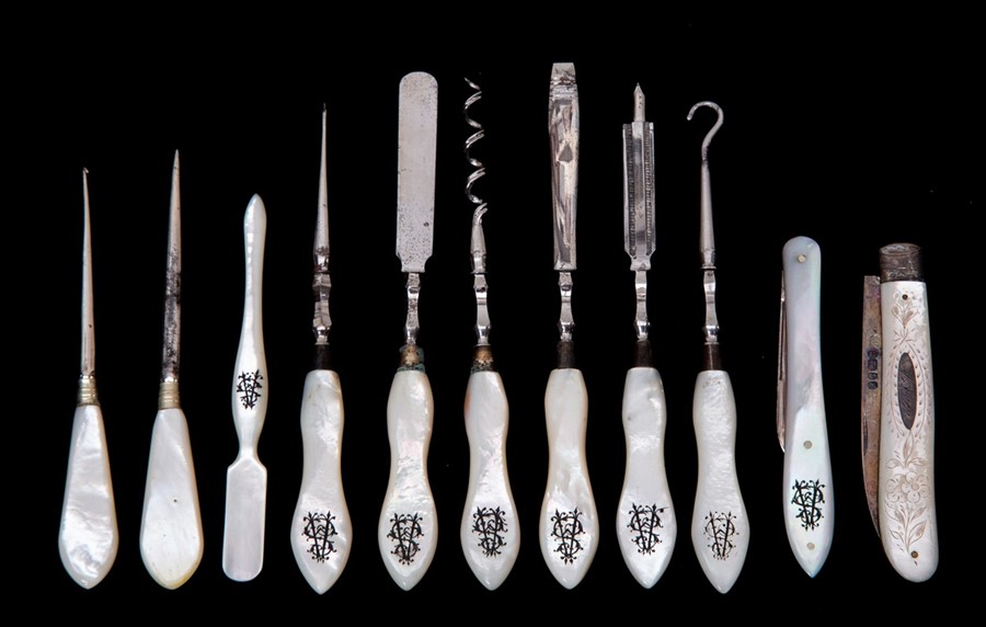 Lot 41 - A silver and mother of pearl fruit  knife, engraved foliate decoration to handle monogrammed